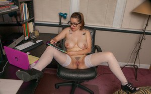 Hot secretary Chelsea Bell strips to her stockings showing pink in the office