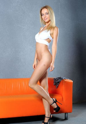 Long legged blonde chick Delilah G removes her clothes and high heels too