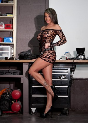 Non nude model Nikki Sims teases in a sexy dress and high heels