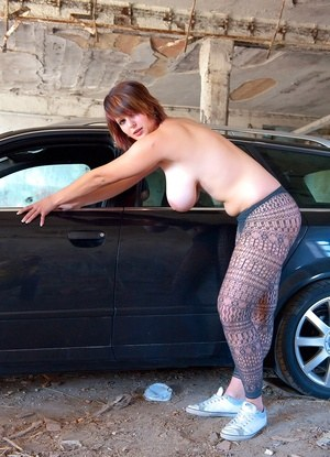 Natural redhead Nika exposes her saggy tits with huge nipples in the garage