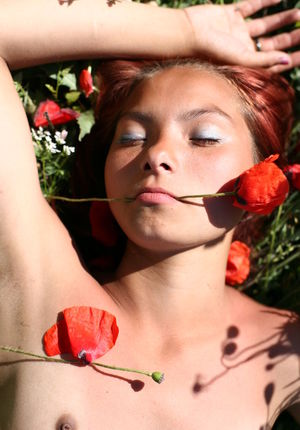 Flat chested tiny teen Nastia A frolics naked in a poppy field