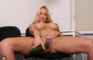 Horny slut with big boobs as a cucumber in her well used fuck hole