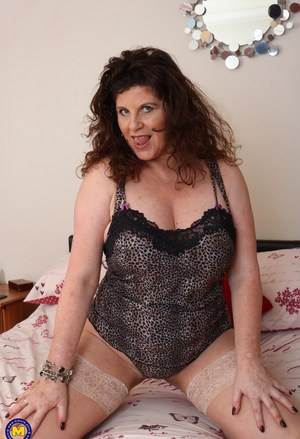 Horny mature woman slips out of her sexy lingerie to rub her old clit