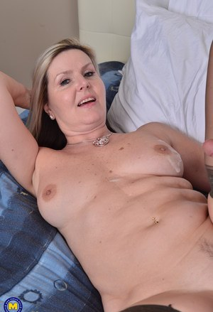 Middle aged woman shows her neighbor's boy the ways of sex in her bedroom