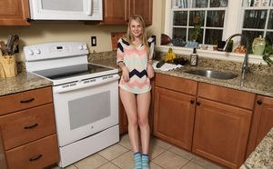 Lily Rader shows her cameltoe before fucking herself with kitchen utensils
