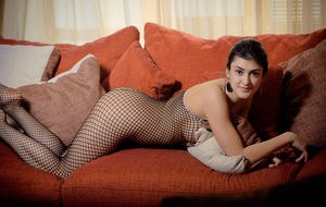 Young Zita B in fishnet catsuit spreading  stretching to show her tight ass