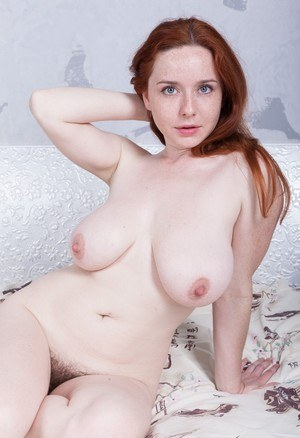 Big titted natural redhead Elouisa spreading to reveal a natural hairy muff