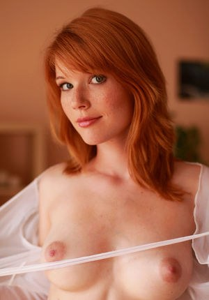 Super sexy redhead Mia Sollis flaunting her perky tits  neat bare snatch