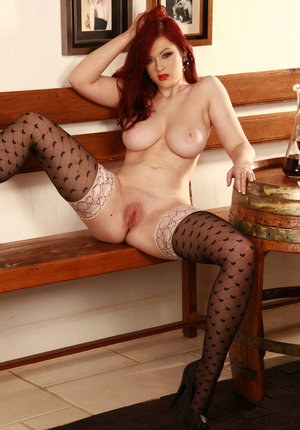 Flaming hot redhead in satin lingerie toys her lonely pussy with a big dildo