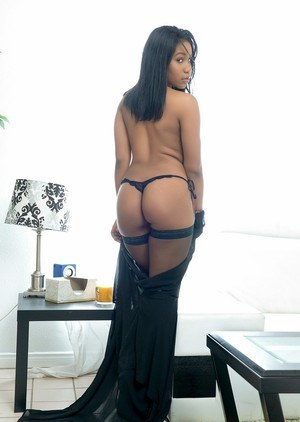 Enticing ebony Jenna Foxx removes black lingerie to lounge naked in stockings