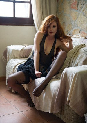 Redhead solo girl Mia Sollis hikes up her dress to expose polka dot panties