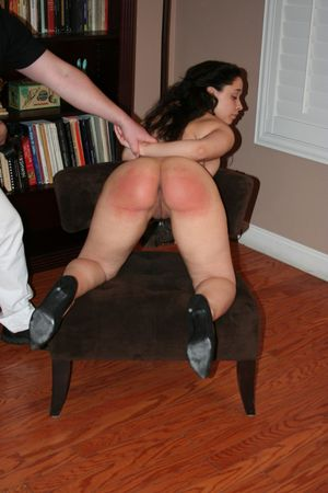 Naked brunette Mackenzie Reed sports a red ass after being punished