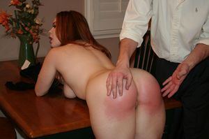 Redhead MILF Summer Hart grabs her bare ass after being spanked over a table
