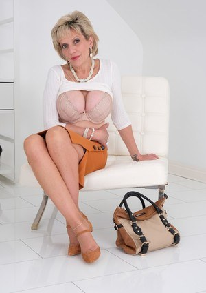 Mature woman Lady Sonia displays some fine legs while baring her hooters