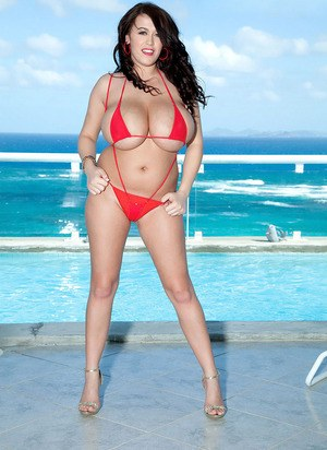 Dark haired bikini model Leanne Crow uncovers her knockers at the beach