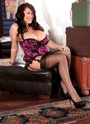 Famous pornstar Leanne Crow uncorks her knockers in black nylons and garters