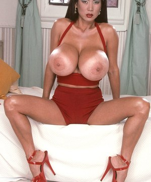 Older Asian woman Minka shows off her great legs and massive boobs
