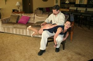 Brunette wife Ten Amorette has her bare ass spanked by her husband