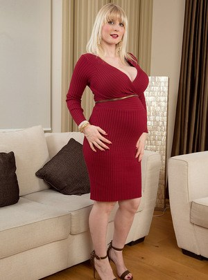 Pregnant female Casey Deluxe hikes up her dress to show her swollen belly