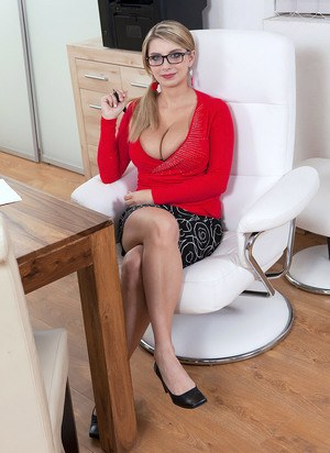 Busty Katarina Dubrova removes her glasses and clothes to pose naked at work