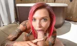 Tattooed female Anna Bell Peaks delivers a POV blowjob in a hot tub
