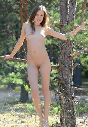 Hot young brunette removes her tight jeans to squat naked in the woods