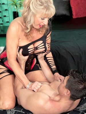 Hot grandmother Phoenix Skye teases her young lover before a blowjob