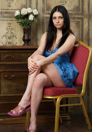 Beautiful brunette Marina H casts her dress aside to model in the nude