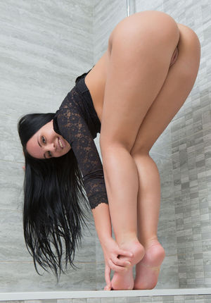 Dark haired solo girl Sable Sharp display her hairless pussy and sexy feet