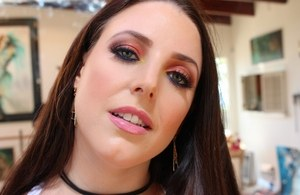 Big boobed brunette Angela White exposes her juicy butt while changing clothes