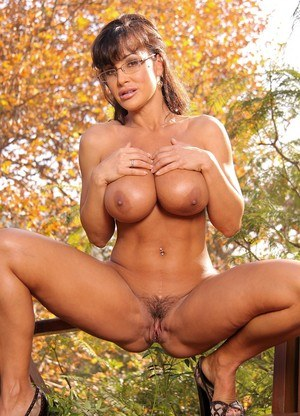 Nerdy female Lisa Ann exposes her big boobs and butt on the back patio
