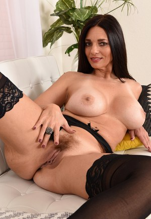 Brunette with big round tits Mindi Mink pets her furry beaver with legs spread