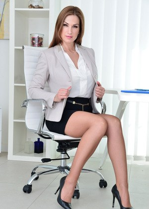Hot MILF Carol Gold strips to her tan stockings to masturbate in her office
