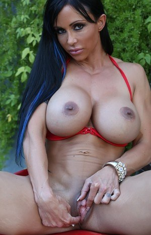 Big titted MILF muscle woman flaunting round tits  engorged clit close up