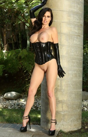 Sexy busty MILF Veronica Avluv in latex squatting & crawling topless outdoors