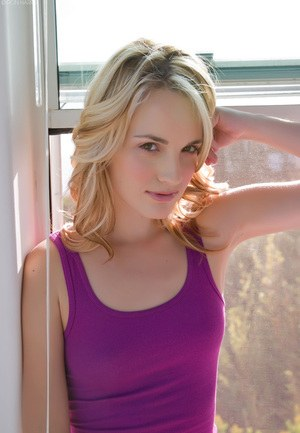 Blonde solo model Sara James poses non nude in a short purple dress