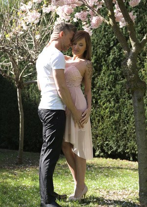 Angel Piaff and Lutro enjoy a sweet moment outside beneath the blossoms of a cherry tree. Their laughter turns to sighs of excitement as Lutro give Angel a hug and then leads her inside. By the time they reach the couch, Angel is all turned on and ready t