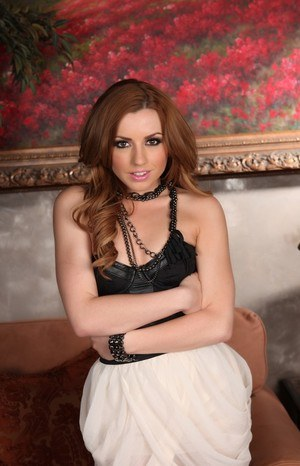 Hot MILF Lexi Belle exposes her neatly trimmed muff as she disrobes