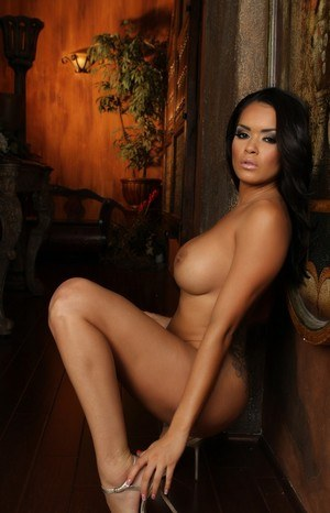 Sultry Latina model Daisy Marie reveals her big tits as she gets naked