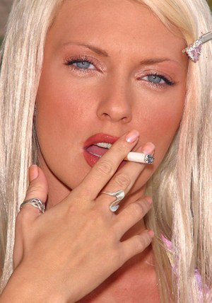 Smoking blonde Kelli Marie steams up the screen with sopping wet panties