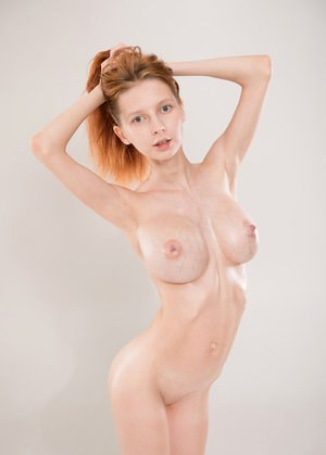 Skinny young redhead Helga reveals a huge set of knockers with hard nipples