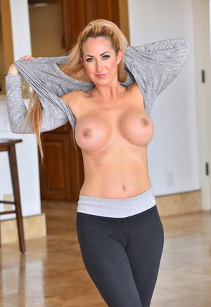 Busty chick Janna sheds her yoga pants to reveal her toned physique