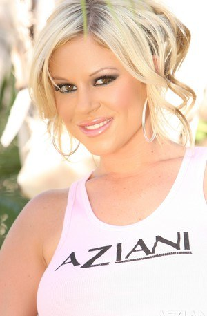 Busty blonde, Ahryan Astyn, is a naughty girl, stripping out of her Aziani gear outside!