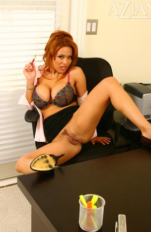 Redhead secretary Sienna West undresses for nude posing in office chair