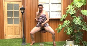 Blonde woman Nicol D hikes short dress to pee standing behind the house