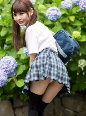 Cutie Japanese schoolgirl in pigtails shows naked ass in no panties upskirt