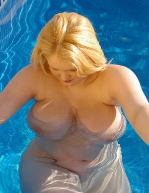 Angry looking nude fatty Ashley Sage Ellison flaunts her huge tits in the pool
