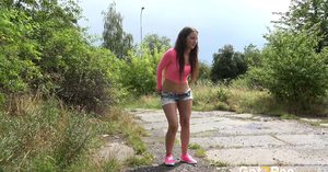 Nicolette Noir drops her denim shorts and squats to relieved pee on the path