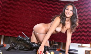 Hot busty brunette Katreena Lee plays with cue in high boots on the pool table