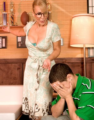 Hot mom Erica Lauren facesitting a young man she's supposed to be tutoring